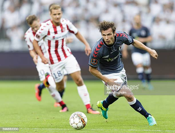 Elmar Bjarnason of AGF controls the ball during the Danish Alka Superliga match between AaB Aalborg and AGF Aarhus at Nordjyske Arena on August 28...