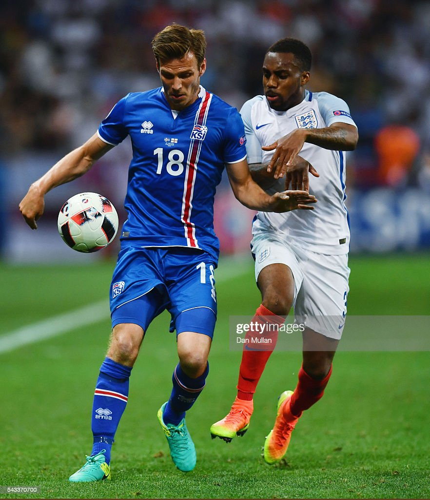 Elmar Bjarnason of Iceland and Danny Rose of England compete for the ball during the UEFA EURO 2016 round of 16 match between England and Iceland at Allianz Riviera Stadium on June 27, 2016 in Nice, France.