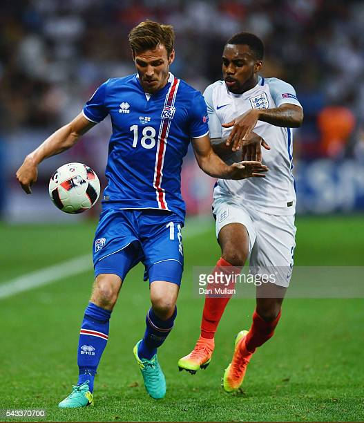 Elmar Bjarnason of Iceland and Danny Rose of England compete for the ball during the UEFA EURO 2016 round of 16 match between England and Iceland at...