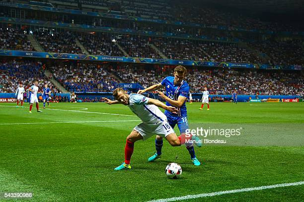 Elmar Bjarnason of Iceland and Jack Wilshere of England during the European Championship match Round of 16 between England and Iceland at Allianz...