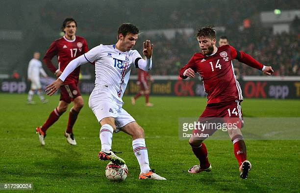 Elmar Bjarnason of Iceland takes on Lasse Schoene of Denmark during the International Friendly match between Denmark and Iceland at the MCH Arena on...