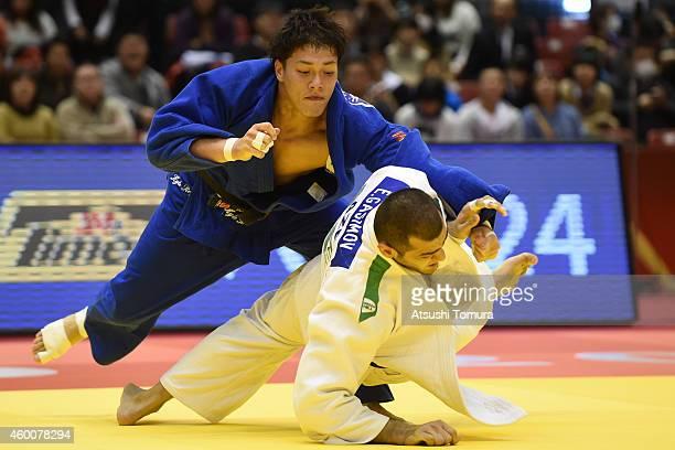 Elmar Gasimov of Azerbaidjan and Kyle Reyes of Canada compete in Men's 100kg during Judo Grand Slam Tokyo 2014 at Tokyo Metropolitan Gymnasium on...
