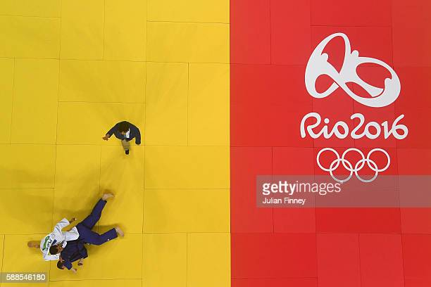 Elmar Gasimov of Azerbaijan competes against Artem Bloshenko of Ukraine during the men's 100kg semifinal of table A judo contest on Day 6 of the 2016...