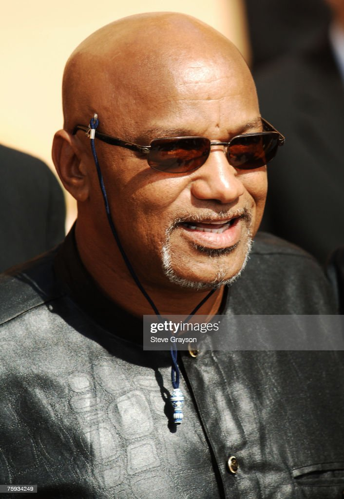 Elmer 'Geronimo' Pratt (left) arrives at the memorial service for Johnnie Cochran at West Angeles Cathederal in Los Angeles, California April 6, 2005