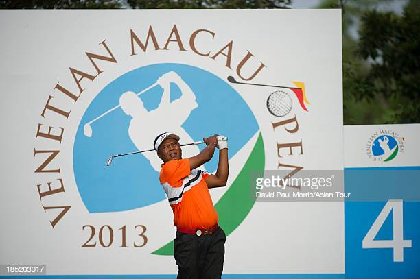 Elmer Salvador of Philippines hits his tee shot on the 4th hole during round two of the Venetian Macau Open on October 18 2013 at the Macau Golf...