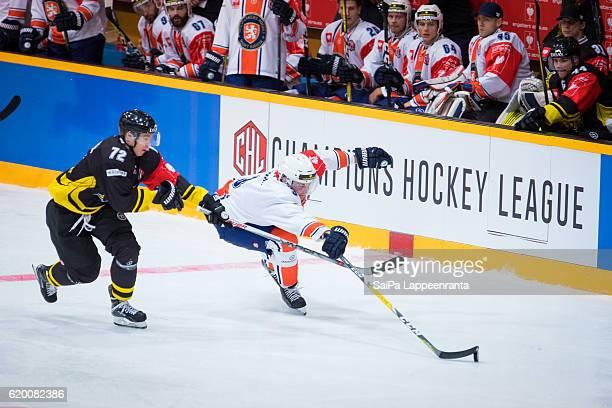 Elmeri Kaksonen of Lappeenranta challenges Oliver Bohm of Vaxjo during the Champions Hockey League Round of 16 match between SaiPa Lappeenranta and...