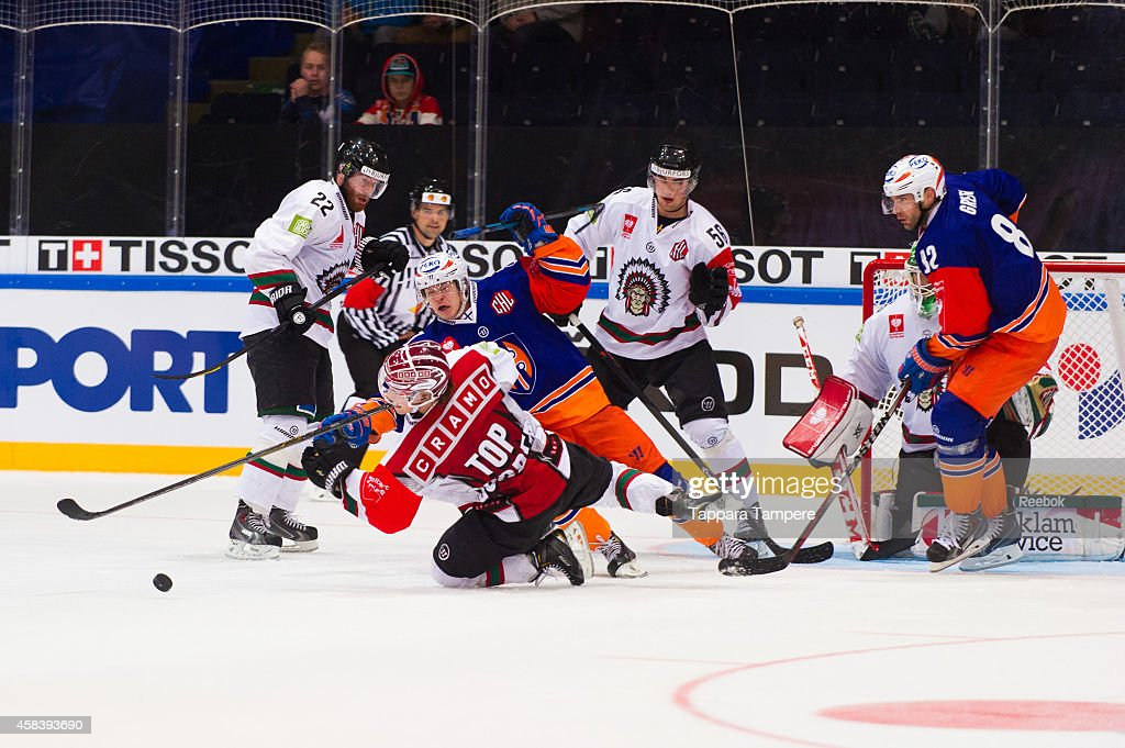Elmerir Kaksonen of Tappara Tampere and #41 Mathis Olimb of Frolunda Gothenburg battle for the puck during the Champions Hockey League round of 16 first leg game between Tappara Tampere and Frolunda Gothenburg at Hakametsa on November 4, 2014 in Tampere, Finland.