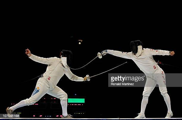 Elmir Alimzhanov of Kazakhstan competes in the Men's Team Epee Final against Jin Sun Jung of South Korea at Guangda Gymnasium during day nine of the...