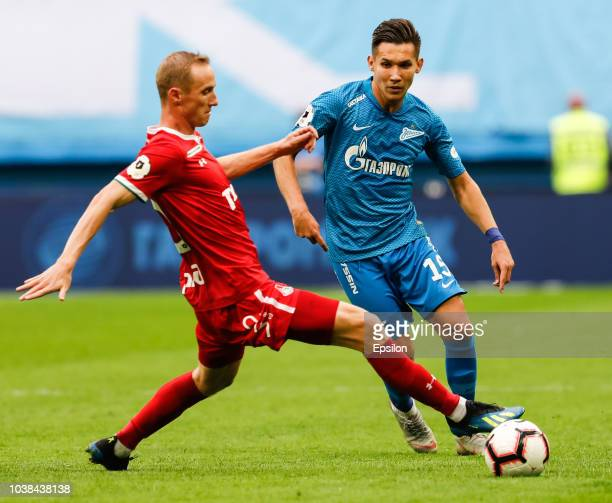 Elmir Nabiullin of FC Zenit Saint Petersburg passes the ball as Vladislav Ignatyev of FC Lokomotiv Moscow defends during the Russian Premier League...