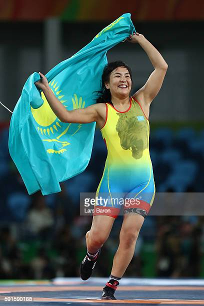 Elmira Syzdykova of Kazakhstan celebrates after defeating Enas Mostafa Youssef Ahmed of Egypt during the Women's Freestyle 69 kg Bronze Final match...