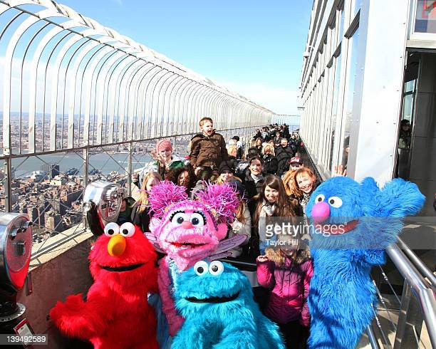 Elmo, Abby Cadabby, Cookie Monster, and Grover visit The Empire State Building on February 21, 2012 in New York City.