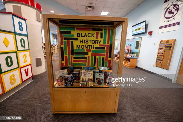 Case displaying books for Black history month at the Elmont Memorial Library in Elmont, New York, on January 29, 2021.