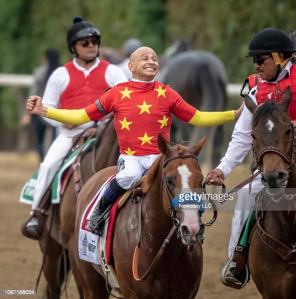 Jockey Mike Smith celebrates after riding Justify to Triple Crown victory during the 150th Running of the Belmont Stakes at Belmont Park in Elmont...