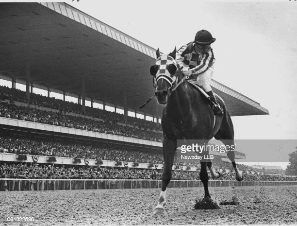 Jockey Ron Turcotte aboard Secretariat looks behind for the other horses on his way to a 31-lengths victory in the Belmont Stakes in Elmont, New York...