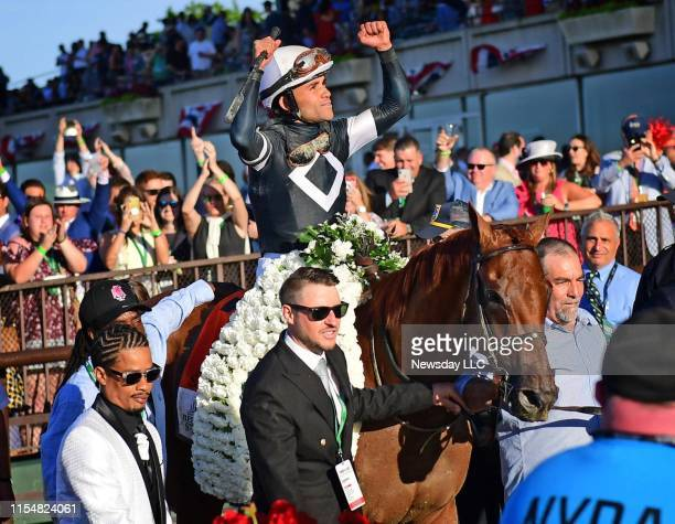 Sir Winston ridden by Jockey Joel Rosario celebrates on his way to the winner's circle after winning the 151st running of the Belmont Stakes at...