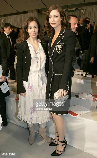 Elodie Bouchez and Anna Mouglalis attend the Chanel fashion show as part of Paris Fashion Week Spring/Summer 2005 on October 8 2004 in Paris France