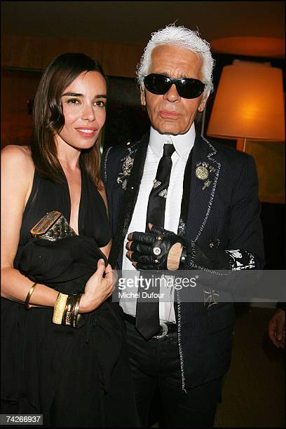 Elodie Bouchez and Karl Lagerfeld attend a dinner sponsored by magazine Madame Figaro to celebrate the Sixtieth Anniversary of the IFF on May 23 2007...