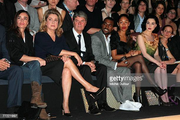 Elodie Bouchez, Catherine Deneuve, Yves Carcelle, Kanye West and his wife, Dita von Teese attends the Louis Vuitton fashion show, during the...