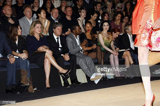 Elodie Bouchez Catherine Deneuve Yves Carcelle Kanye West and wife Dita von Teese attends the Louis Vuitton fashion show during the Spring/Summer...
