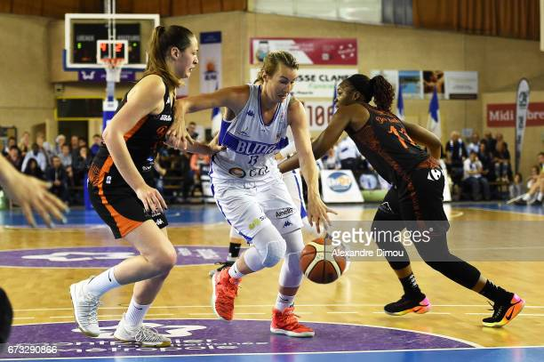 Elodie Godin of Montpellier and Alexia Chartereau and Clarissa Dos Santos of Bourges during the Women's basketball match between Lattes Montpellier...
