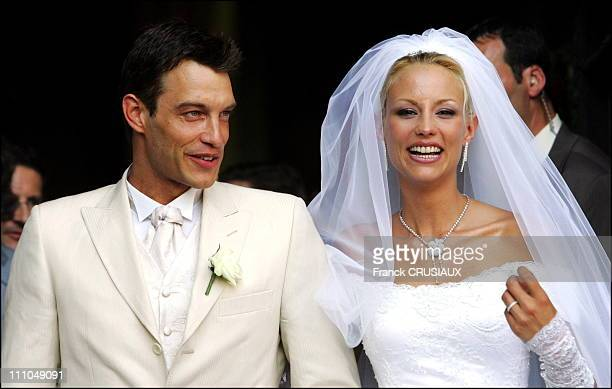 Elodie Gossuin and Bertrand Lacherie leave the church after the religious ceremony in Compiegne France on July 01st 2006