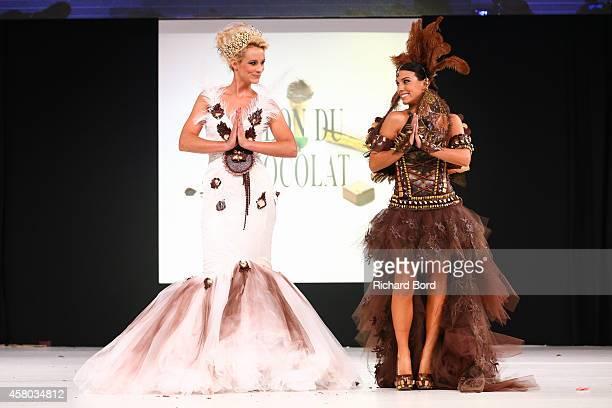 Elodie Gossuin and Ludivine Sagna walk the runway during the Fashion Chocolate show at Salon du Chocolat at Parc des Expositions Porte de Versailles...