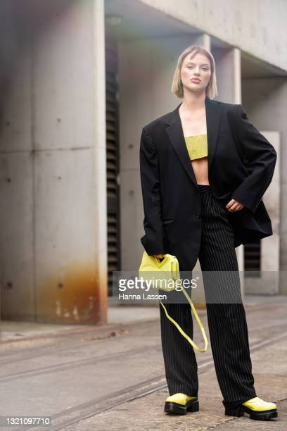 Elodie Russell wearing Nue Studio top, Dion Lee blazer and pants and Bottega Veneta neon yellow shoes and bag at Afterpay Australian Fashion Week...