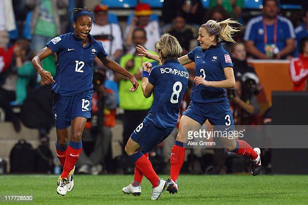 Elodie Thomis of France celebrates her team's fourth goal with team mates Sonia Bompastor and Laure Boulleau during the FIFA Women's World Cup 2011...