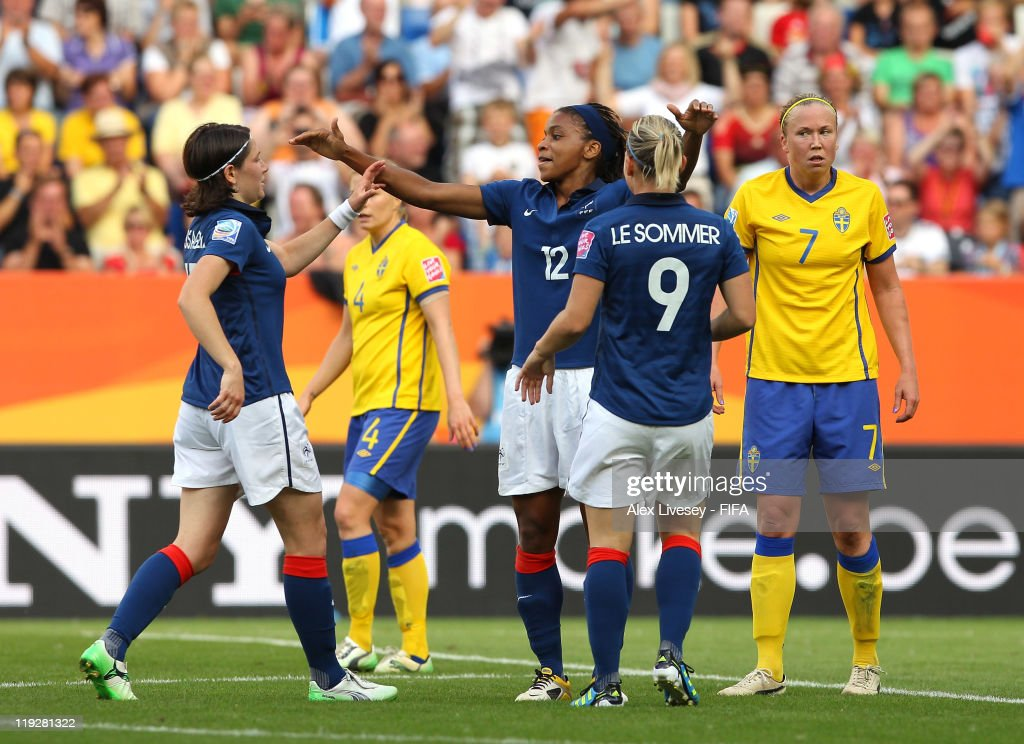 Elodie Thomis (12) of France celebrates with Eugenie Le Sommer (9) and Elise Bussaglia after scoring her goal during the FIFA Women's World Cup 3rd Place Playoff between Sweden and France at Rhein-Neckar Arena on July 16, 2011 in Sinsheim, Germany.