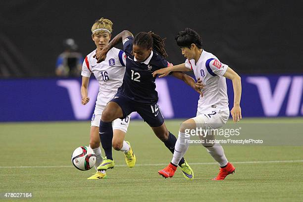 Elodie Thomis of France controls the ball against Eunmi Lee and Yumi Kang of Korea during the FIFA Women's World Cup Canada 2015 round of 16 match...