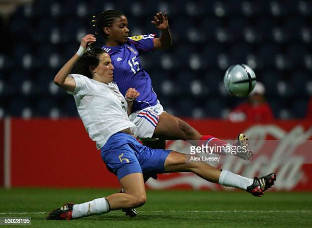 Elodie Thomis of France is tackled by Elisabetta Tona of Italy during the Women's UEFA European Championship 2005 Group B game between France and...