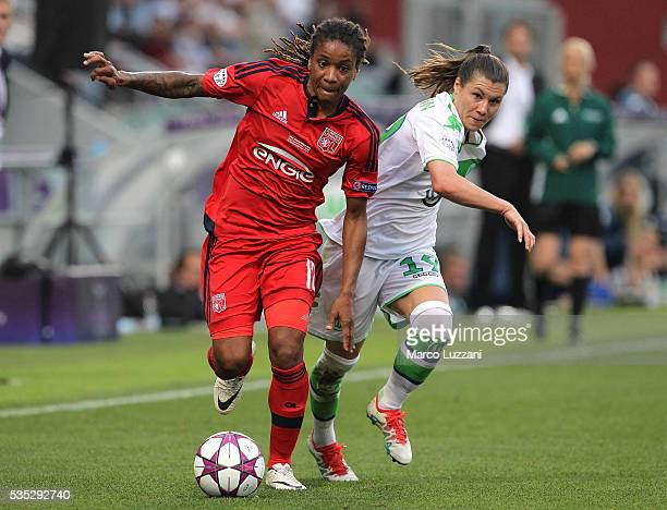 Elodie Thomis of Olympique Lyonnais competes for the ball with Ramona Bachmann of VfL Wolfsburg during the UEFA Women's Champions League Final VfL...