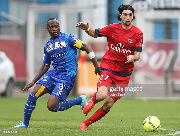 Eloge Enza Yamissi of Troyes and Javier Pastore of PSG in action during the Ligue 1 match between ES Troyes Aube Champagne ESTAC and Paris...