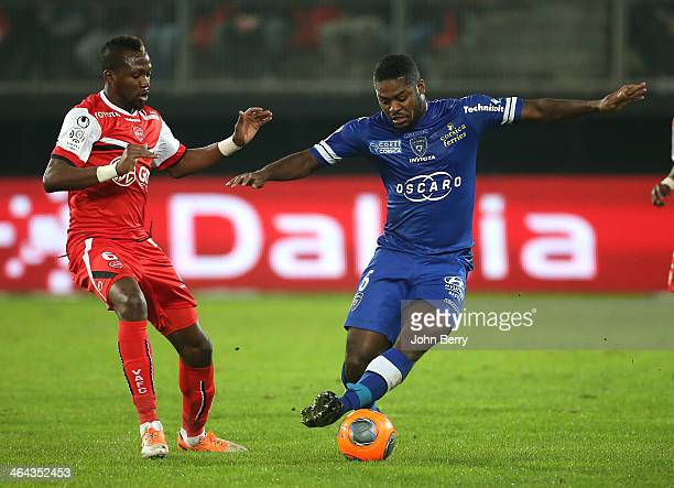 Eloge Enza Yamissi of Valenciennes and Koffi Romaric N'Dri of Bastia in action during the french Ligue 1 match between Valenciennes FC and SC Bastia...