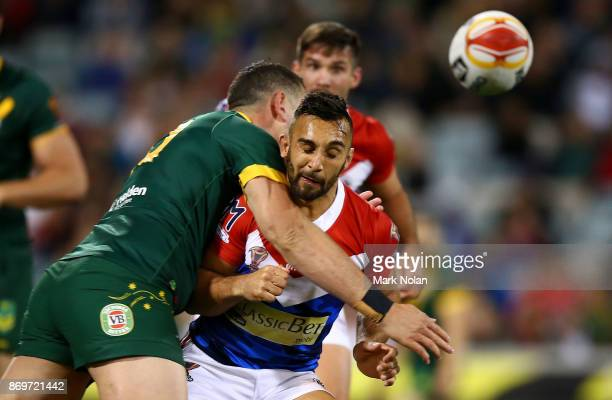 Eloi Pelissier of France is tackled late after passing the ball during the 2017 Rugby League World Cup match between Australian Kangaroos and France...