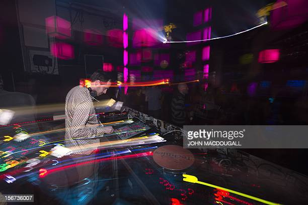 BY Eloi ROUYER German electronic musician and producer Ulrich Schnauss spins some tunes at Berlin's Suicide Circus night club on November 17 2012 AFP...