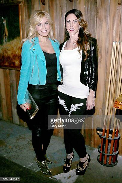 Eloise DeJoria and Alexis DeJoria pose during the launch party of Jesse James Firearms Unlimited at the Rattle Inn on November 16 2013 in Austin Texas
