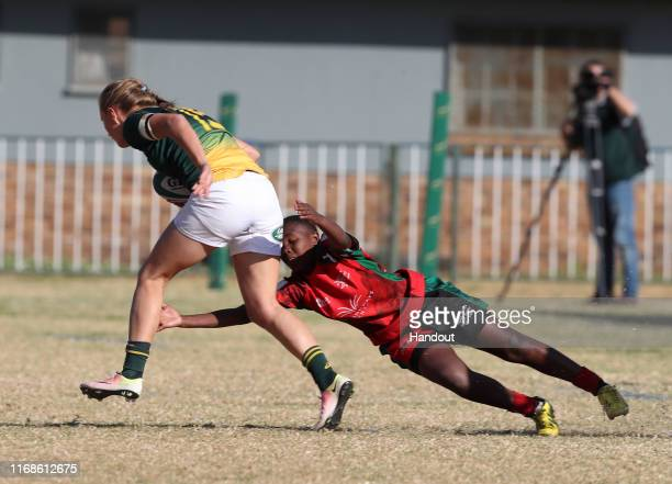 Eloise Webb of South Africa tackled by Veronicah Wanjiku of Kenya during 2019 Rugby Africa Women's Cup match between South Africa and Kenya at the...