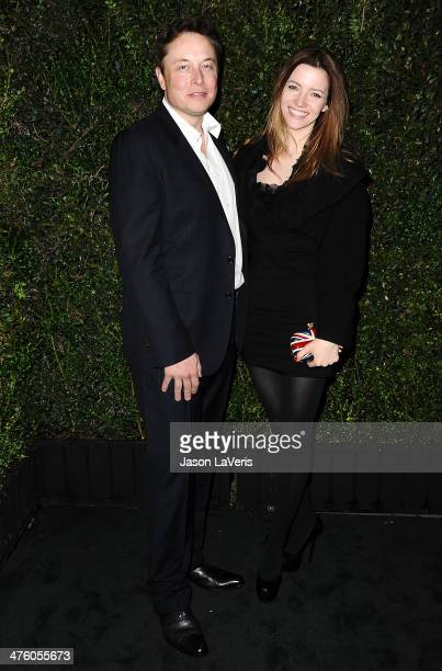 Elon Musk and Talulah Riley attend the Chanel and Charles Finch preOscar dinner at Madeo Restaurant on March 1 2014 in Los Angeles California