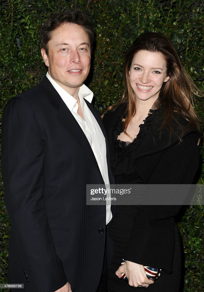 Elon Musk and Talulah Riley attend the Chanel and Charles Finch pre-Oscar dinner at Madeo Restaurant on March 1, 2014 in Los Angeles, California.