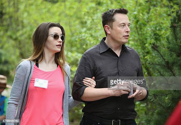 Elon Musk, CEO and CTO of SpaceX, CEO and product architect of Tesla Motors, and chairman of SolarCity, and his wife Talulah Riley attend the Allen &...