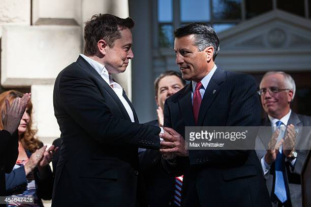 Elon Musk CEO of Tesla Motors is introduced by Governor Brian Sandoval of Nevada during a press conference at the Nevada State Capitol September 4...