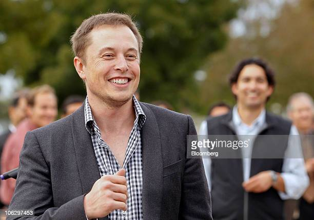 Elon Musk chairman and chief executive officer of Tesla Motors Inc smiles during the official opening ceremony of the new Tesla Motors auto plant...