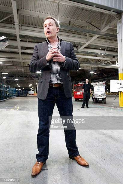 Elon Musk chairman and chief executive officer of Tesla Motors Inc speaks with reporters during a tour of the Tesla Motors auto plant formerly...