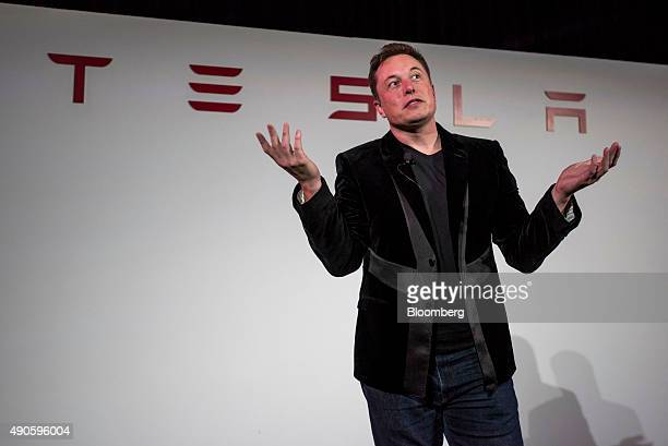 Elon Musk chairman and chief executive officer of Tesla Motors Inc gestures as he speaks during a news conference prior to unveiling the Model X...