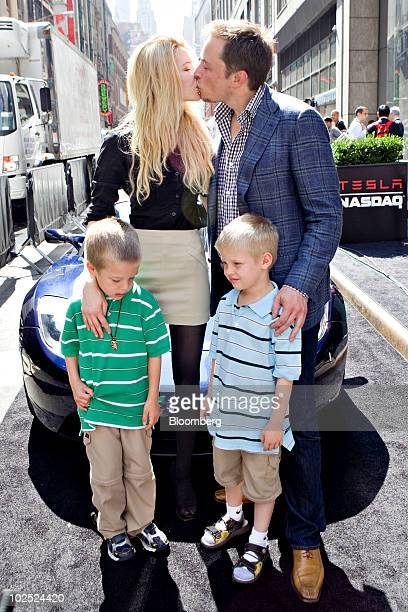 Elon Musk, chairman and chief executive officer of Tesla Motors, kisses his fiancee Talulah Riley as they stand with Musk's twin boys Griffin, left,...