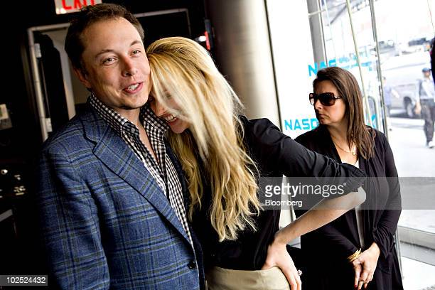 Elon Musk, chairman and chief executive officer of Tesla Motors, left, stands with his fiancee Talulah Riley after ringing the opening bell at the...