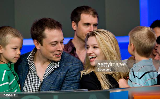 Elon Musk, chairman and chief executive officer of Tesla Motors, second from left, participates in the opening bell ceremony with his twin boys...