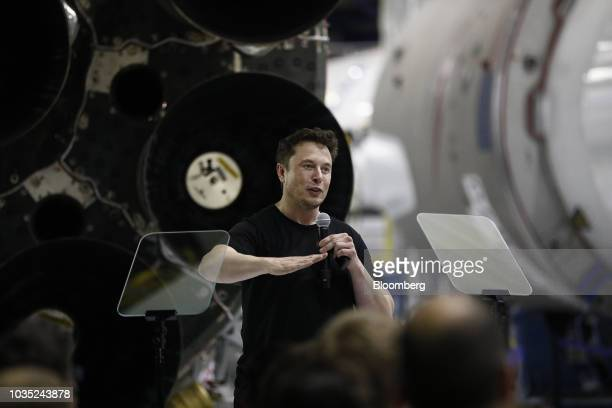 Elon Musk chief executive officer for Space Exploration Technologies Corp gestures as he speaks during an event at the SpaceX headquarters in...