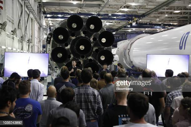 Elon Musk chief executive officer for Space Exploration Technologies Corp center left speaks as Yusaku Maezawa founder and president of Start Today...